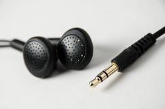 Schwarzes Ohrtelefon und -Buchse Lizenzfreies Stockbild