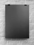 Schwarzes Plakat auf einem Seil lizenzfreie stockfotos