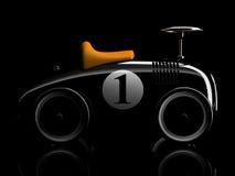 Schwarzes Retro- Spielzeugautonummer eins lokalisiert auf schwarzem Hintergrund Stockbild