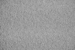 Schwarzes Sandbeschaffenheit blackground Lizenzfreies Stockbild