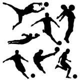 Schwarzes Schattenbild des Fußballspielers in den verschiedenen Haltungen auf weißem Hintergrund stockfotos