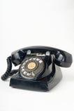 Schwarzes schmutziges gebrochenes Telefon der alten Art Stockfotos