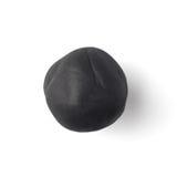 Schwarzes Stück Plastik auf einem weißen Hintergrund Stockfotografie