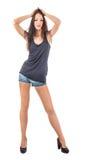 Schwarzes T-Shirt und blaue kurze Hosen Stockbild