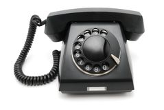 Schwarzes Telefon mit einer Platte Stockfotografie