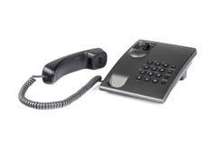 Schwarzes Tischplattentelefon mit gerundeten Knöpfen Nahaufnahme Lizenzfreie Stockfotos