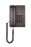 Schwarzes Tischplattentelefon mit gerundeten Knöpfen Nahaufnahme Lizenzfreie Stockbilder