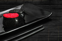 Schwarzes tobiko, rotes tobiko Lizenzfreies Stockbild