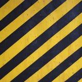 Schwarzes und gelbes WARNING stripes Hintergrund Stockfoto