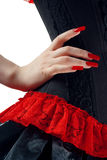 Schwarzes und rotes Korsett mit der Hand lizenzfreies stockbild