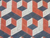 Schwarzes und rotes Muster der abstrakten geometrischen Ziegelsteinstein-Pflasterung Lizenzfreies Stockbild