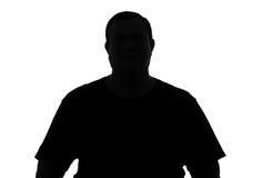 Schwarzes und Whit stellen Schattenbild des dicken Mannes auf einem weißen Hintergrund gegenüber Stockfotografie