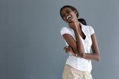 Schwarzes vorbildliches Lachen herzlich stockbilder