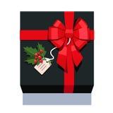 Schwarzes wickelte die Geschenkbox ein, die mit rotem Bogen verziert wurde Stockbild