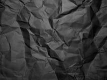 Schwarzes zerknitterte Papierbeschaffenheit Geknitterter Papierhintergrund Stockfotografie