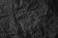Schwarzes zerknittertes Papier Stockfotos