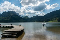 Schwarzsee, FR / Switzerland - 1 June 2019: tourist people enjoy a visit to Lake Schwarzsee in Fribourg as a family vacation. Tourist people enjoy a visit to stock photo