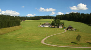 Schwarzwald / Black Forest. Black Forest. Beautiful landscape with a small house and the road royalty free stock image
