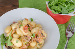 Schwarzwald gnocchi with ham, onion and wine Royalty Free Stock Photo