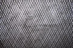 Schwarzweiss-Beschaffenheit aus Draht heraus oder steeckmetall als Hintergrund mit orange Tönung Lizenzfreies Stockfoto