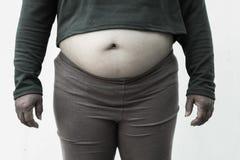Schwarzweiss-Bildart für Nahaufnahme der fetten Frau auf weißem Hintergrund Konzept für Korpulenzfrage, Diät des Lebensmittels fü Stockfotografie