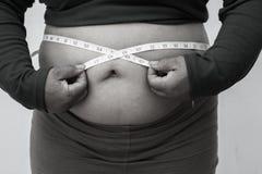 Schwarzweiss-Bildart für Nahaufnahme der fetten Frau auf weißem Hintergrund Konzept für Korpulenzfrage, Diät des Lebensmittels fü Lizenzfreie Stockfotos
