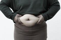 Schwarzweiss-Bildart für Nahaufnahme der fetten Frau auf weißem Hintergrund Konzept für Korpulenzfrage, Diät des Lebensmittels fü Stockfoto