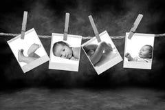 Schwarzweiss-Fotographien, die an einem Seil durch C hängen Stockbilder