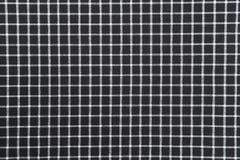 Schwarzweiss-Ginghamstoffhintergrund mit Gewebebeschaffenheit Stockfotos