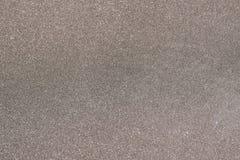 Schwarzweiss-Sandbeschaffenheitshintergrund stockfoto