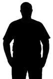 Schwarzweiss-Schattenbild eines Mannes mit einer dichten Konstitution ist Stockfotos