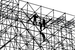 Schwarzweiss-Schattenbild von Bauarbeitern Stockfotografie