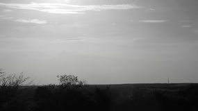 Schwarzweiss-Sonnenuntergang Stockfotos