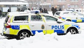 Schwedische Polizeiwagen parkten einen Wintertag Lizenzfreie Stockfotografie