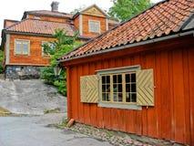 Schwedische rote und gelbe Kabine Stockfotos