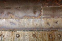 Schweißender alter Eisenhintergrund der Naht Lizenzfreie Stockbilder