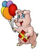 Schwein mit Geschenk Stockbild
