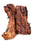 Schweinefleisch briet auf dem Grill, der auf weißer Platte sitzt Lizenzfreies Stockbild