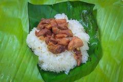 Schweinefleisch gebraten und Reis Stockbild