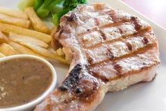 Schweinefleisch-Steak Stockfoto