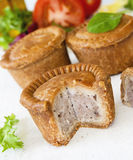 Schweinefleisch-Torten Stockfotos