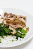 Schweinefleischbein mit Reis Stockfotografie