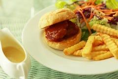 Schweinefleischburger lizenzfreie stockbilder