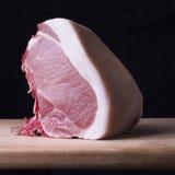 Schweinefleischkotelett mit einem Knochen Stockbilder