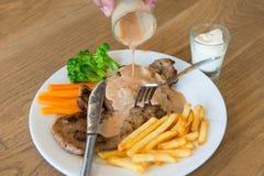 Schweinefleischsteak mit Soße Kuroda Abu Ta köstlich Lizenzfreie Stockfotos