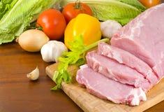 Schweinefleischzartes lendenstück zugebereitet für das Kochen Stockbild