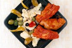 Schweinekotelett und Rippen mit Rinforzo Salat Lizenzfreies Stockfoto