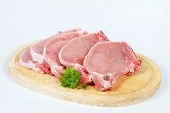 Schweinekoteletts mit den Knochen Stockbild