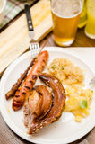 Schweinshaxe and wurst Royalty Free Stock Photos