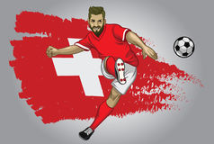 Schweiz fotbollspelare med flaggan som en bakgrund Arkivbilder